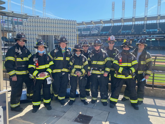 Photo of firefighters at stair climb fundraiser.